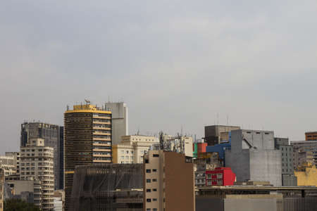 San Paolo skyline with old residential and commercial buildings with antennas on the roofs. One of the buildings is currently under maintenance. Brazil. South America. No people