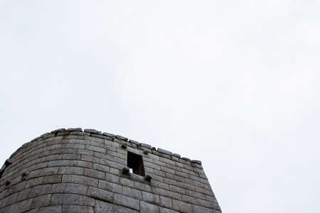 Stone magical ancient ruins along the paved path Inca Trail to Machu Picchu in Peru.