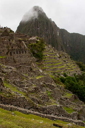 Vertical view of Machu Picchu ancient lost city in the Andes nature.