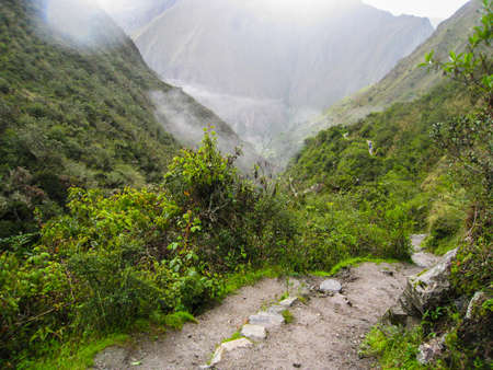 Ancient Inca Trail paved path to the lost city of Machu Picchu. Peru. South America. No people Stock Photo