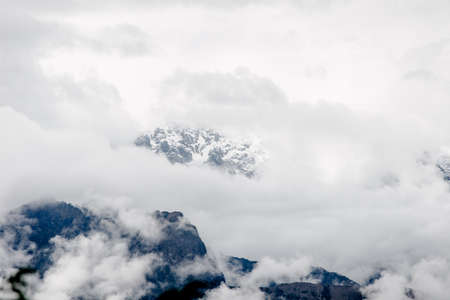 Intense fog and clouds covering the mountains on the Andes viewed from a higher peak on the Inca Trail to Machu Picchu, Peru. Amazing wallpaper.