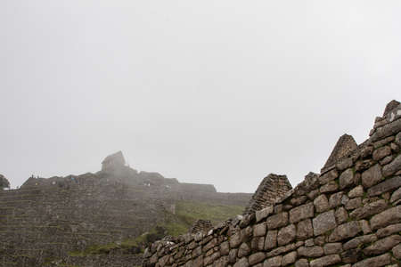 Stone ancient ruins lost in the nature of the Andes mountains. Peru. South America. No people. Stock Photo