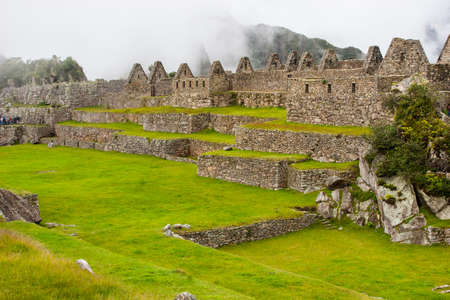 Ruins of Machu Picchu ancient lost city in the Andes nature. Moutains in mist. Peru. South America. No people.