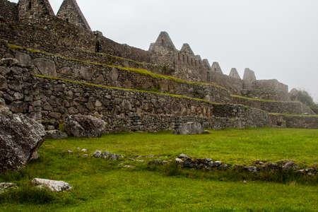 Ruins of Machu Picchu ancient lost city in the Andes nature in mist. Peru. South America. No people. 写真素材 - 105279927
