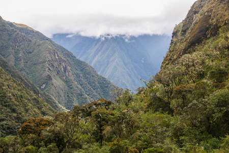 The nature in the mountains with clouds in the background covering the peak. Andes. Peru. No people. 写真素材 - 104917488