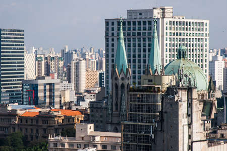 Se is the main cathedral of San Paolo metropolis in Brazil. In the background we can see the skyline of the megalopolis. Standard-Bild