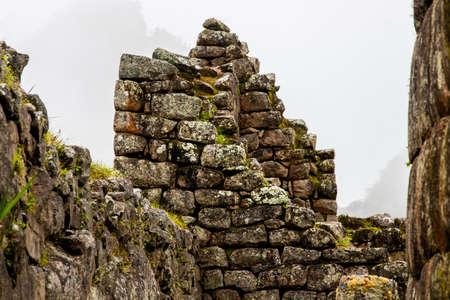 Architecture detail of Inca stone ruins at Machu Picchu. Peru. South America. No people.