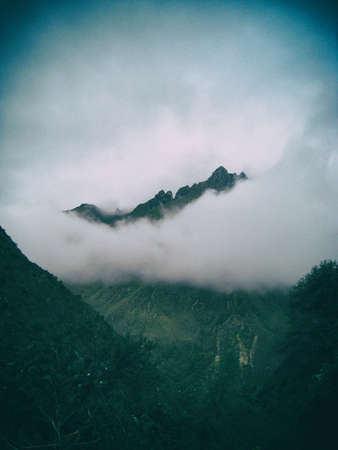 View of an Andes peak mountain covered in mist from the Inca Trail to Machu Picchu. Peru, South America. No people.