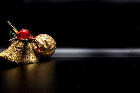 Cool holidays wallpaper background of Christmas decorations and balls or baubles on black background.