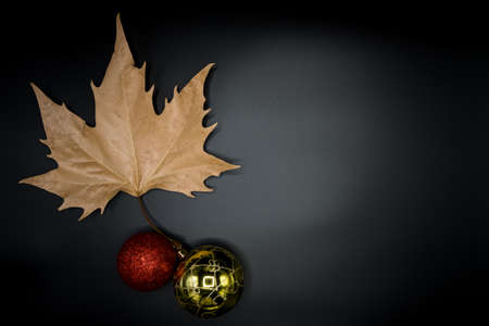 Beautiful autumn wallpaper background of dry leaves isolated on black with Christmas decorations. Stok Fotoğraf