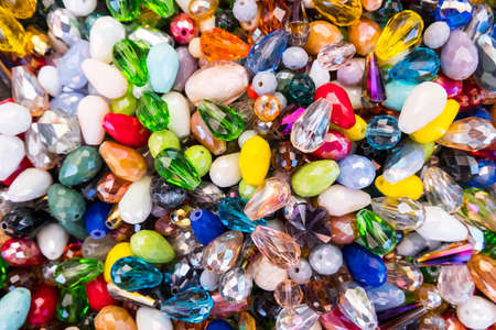 Beautiful wallpaper background of colorful jewelery beads of many shapes and materials. 写真素材