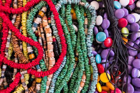Wallpaper background of colorful necklace made of gemstones and colored beads showcased in a shop. Semi precious jewelery.