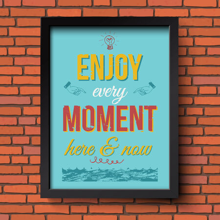 headpiece: Enjoy every moment here and now. Stylized retro poster in a frame. Brick wall background. Vector illustration.
