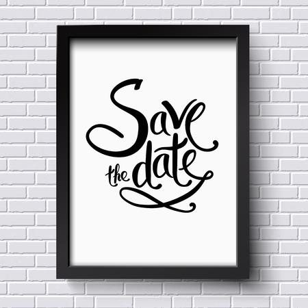 Diseño de texto sencillo para Save the Date Concept en un marco de Blanco y Negro que cuelgan en una pared de ladrillo blanco.