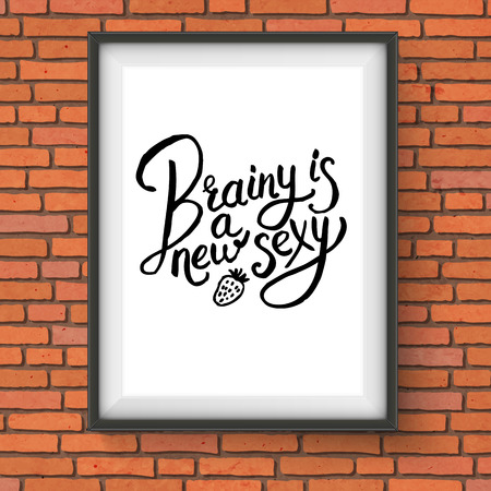 brainy: Close up Simple Text Style for Brainy is a New Sexy Concept with Strawberry Design on a Black and White Frame Hanging on a Brick Wall.