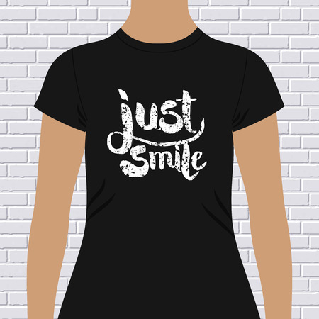 chest wall: Just Smile inspirational t-shirt design with grunge textured text on a black garment modeled on a person against a white brick wall Illustration