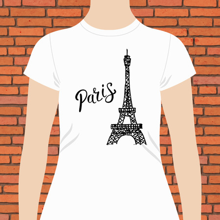 iconic architecture: Casual White Woman Shirt Template, with Paris Text and Famous Eiffel Tower Design in Black, on Brick Wall Background.