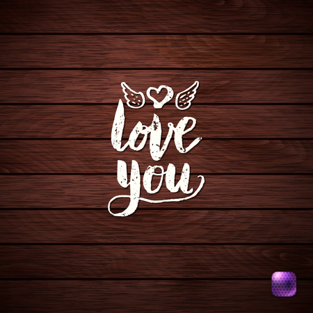 Love Concept - Simple White Love You Text on Wooden Background, Emphasizing Heart with Wings.