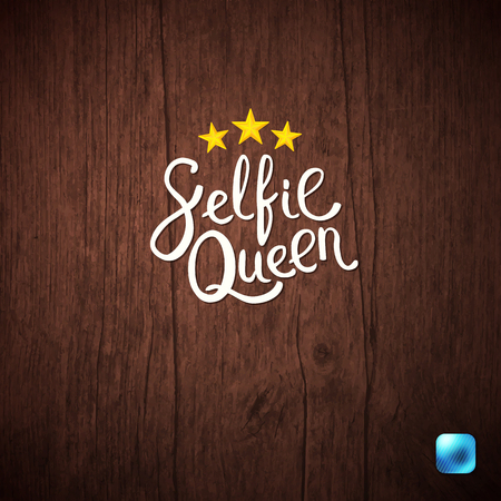 Selfie Queen Texts in Hand Written Font Style on an Abstract Wooden Background.