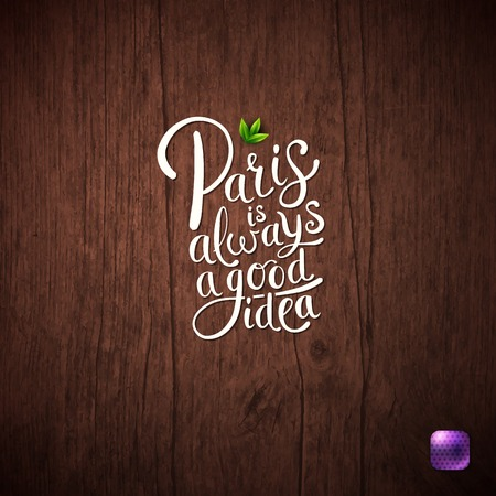 Simple Graphic Design for Paris is Always a Good Idea Concept with Green Leaves, Purple Button on Wooden Background.