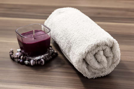 Soft white cotton towel and candles  spa collection