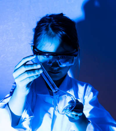 Little girl playing scientist with  flask. Stock Photo