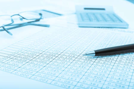 Calculator and the financial report blue toned Financial photo