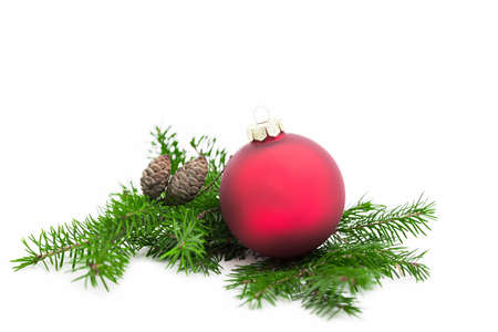 Christmas ball and green spruce branch on white  写真素材