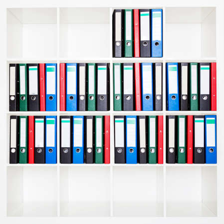 File folders, standing on the shelves at office. Stock Photo