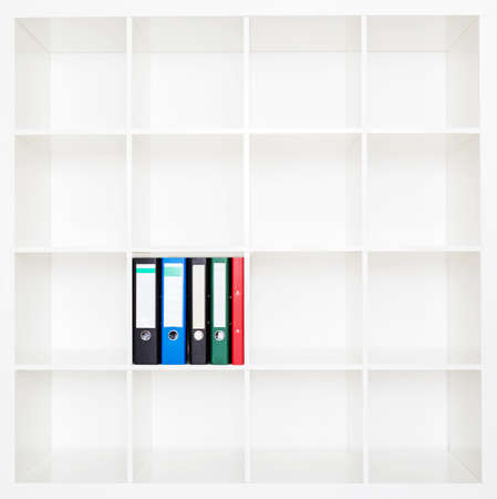 File folders, standing on the shelves at office. Archivio Fotografico