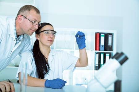 Two scientist  in laboratory. research in laboratory