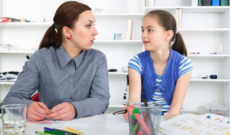 the weariness: Mother Helping Daughter With Homework Stock Photo