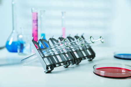 micropipette: DNA samples are loaded  plate for PCR analysis. Stock Photo