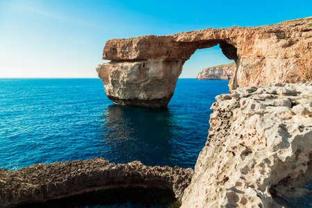 Azure Window, famous stone arch of Gozo island in the sun in summer, Malta.