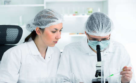 formulae: Team of scientists in a laboratory working on chemical testing
