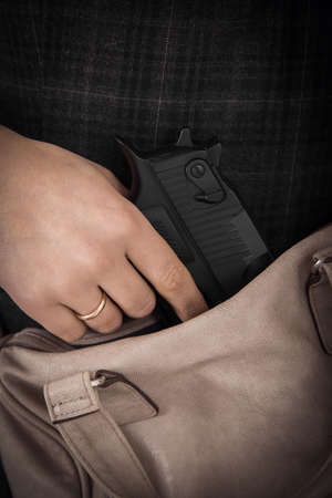 self control: Woman with Concealed Weapon
