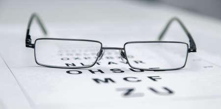 sight chart: Clear Black modern glasses on a eye sight test chart