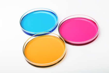 stinks: Petri dishes with a colored liquids on white