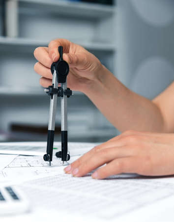 Architects workplace - architectural project, blueprints, ruler and divider. Construction concept. Engineering tools. Stock Photo