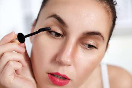 applying makeup: Mascara Applying. Makeup Closeup.Eyes Make-up.