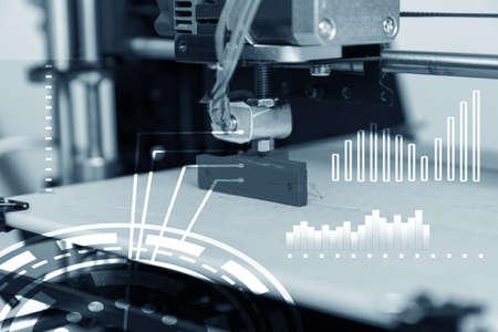 Electronic three dimensional plastic printer during work , 3D printer, 3D printing 写真素材