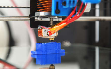 Electronic three dimensional plastic printer during work , 3D printer, 3D printing Stock Photo
