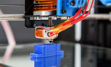 Electronic three dimensional plastic printer during work , 3D printer, 3D printing Фото со стока