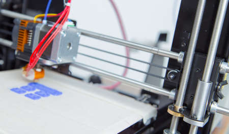 additive manufacturing: Electronic three dimensional plastic printer during work , 3D printer, 3D printing Stock Photo