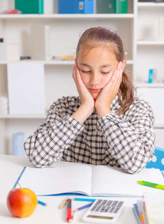learning by doing: Teenage girl preparing for exams. Teenage girl doing homework for school.