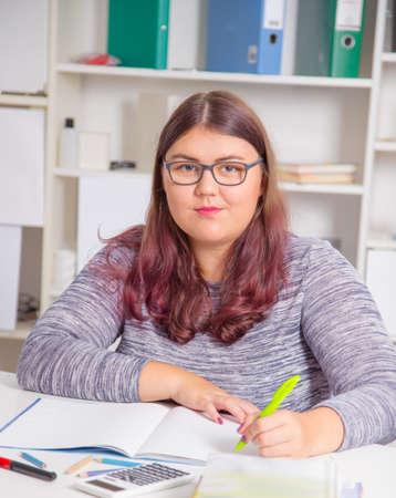 learning by doing: Teenage girl preparing for exams.Teenage girl doing homework for school.