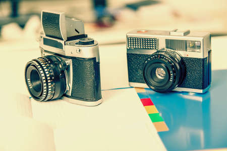 black and white photograph: Old retro camera . Vintage camera on vintage abstract background