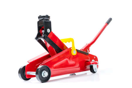 Red hydraulic floor jack isolated on white background. Banque d'images