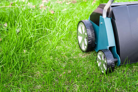 Scarifier on green grass. Work in the garden. scarifier