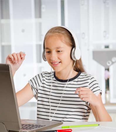 Teenage girl preparing for exams. Teenage girl doing homework.